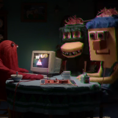 The characters at the table as seen during episode 4.