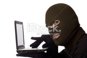 Stock-photo-16393841-computer-hacker-with-mask