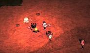 5 osób przy ognisku
