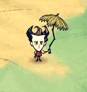 Wilson trzymający tropikalny parasol
