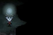Wilson obok otchłani w jaskini