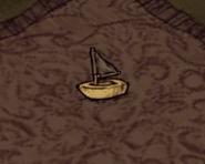 Zabawkowa łódka na ziemi