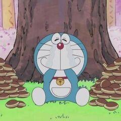 Doraemon happily eating the dorayaki.