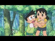 Shizuka pulling Suneo's hands