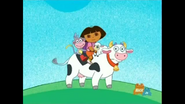 Dora, Boots, and Little Lamb riding on the cow