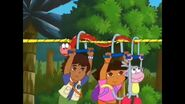 The snake helping Dora, Boots, and Diego through the zip line