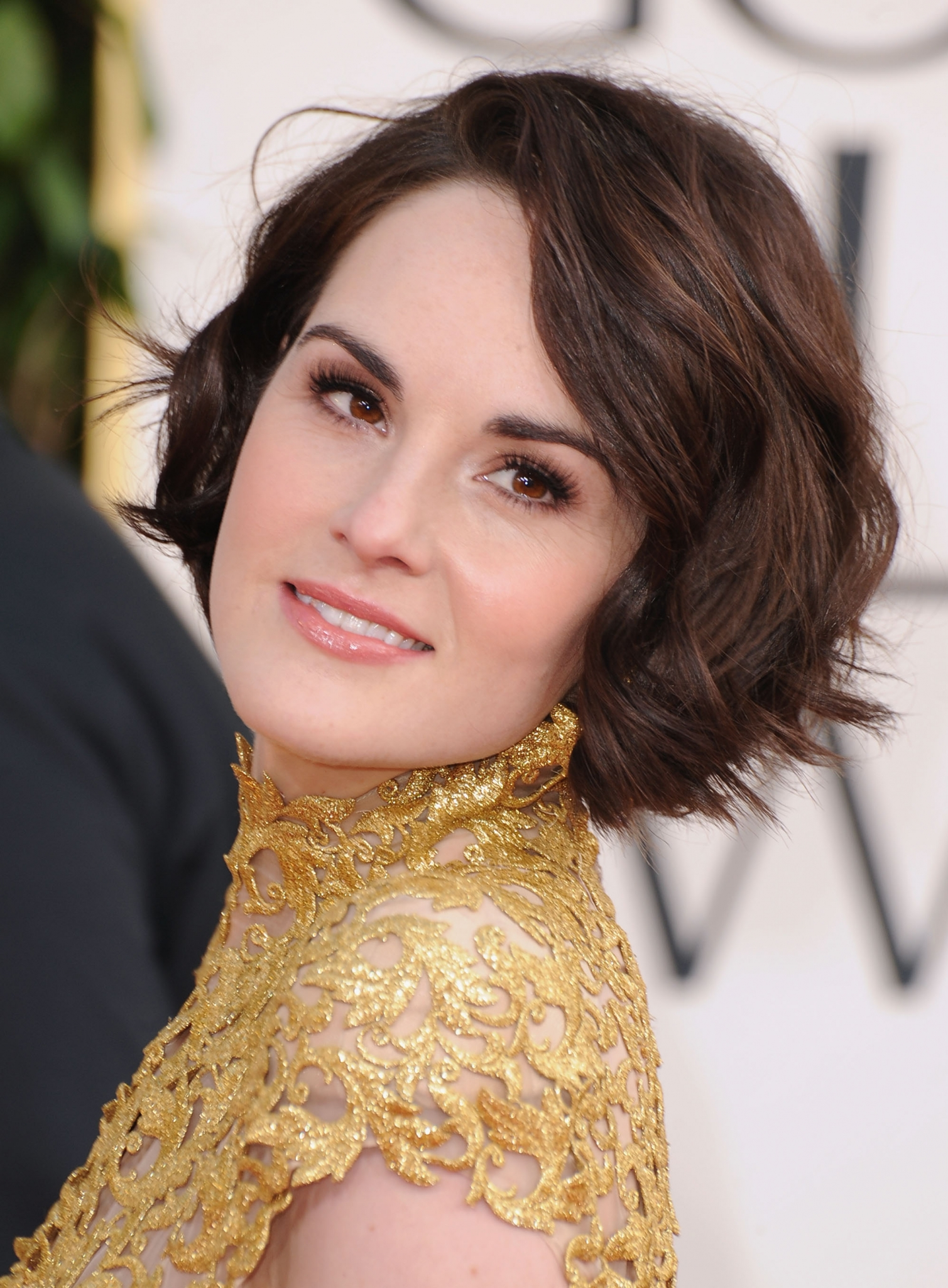 Image Michelle Dockery gold dress short hair