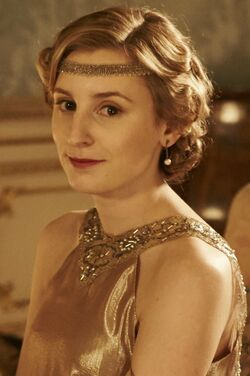 Edith in gold with headband