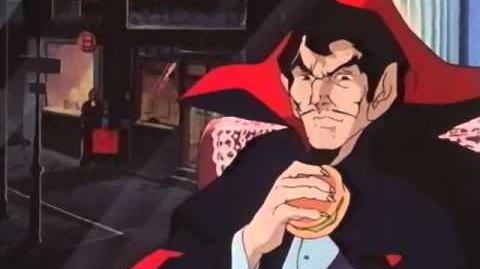 Dracula eating a burger