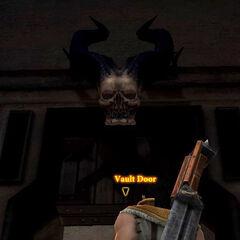 An ogre's skull hangs above the vault door.