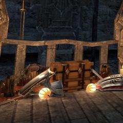 Skrzynia z wyrzuconym orężem i zbroją