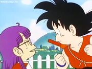 Arale talking to Goku