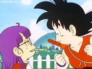 Arale talking to Goku