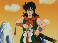 Yamcha taking out his sword to battle goku