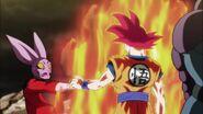 Goku Super Saiyan Dios detiene a Dispo