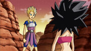 Cabba mostra come trasformarsi in Super Saiyan a Caulifla