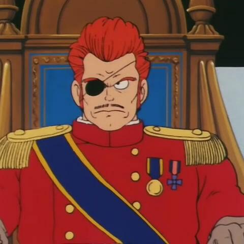 Il comandante Red seduto sulla poltrona.