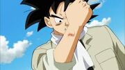 Goku getting scratched by bullet