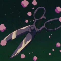 Pual trasformato in un paio di forbici.