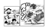 Goku punches the martial artist in the stomach hard