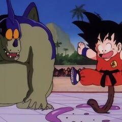 Son Goku che saltella sulla sua coda ricresciuta.