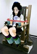 Videl clamped to a chair