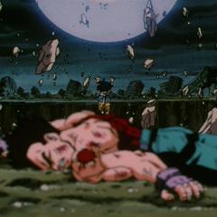 Гоку поднимается из кратера начав копить Сверх Ультра Генки Даму