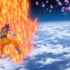Супер Сайян Бог Гоку собирается отражать множественные энергетические атаки Бируса