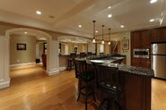 Remarkable-basement-renovation-with-ample-space-to-entertainment-also-l-shape-black-marble-kitchen-bar-table-on-laminate-wooden-floor