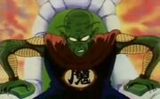 King piccolo sitting in a chair