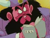 King yemma looking in book