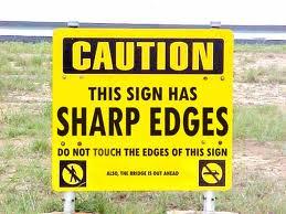 Sharp-edged sign