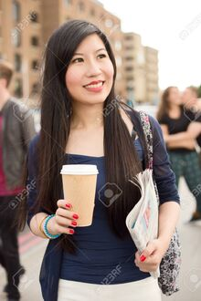 47987811-japanese-girl-with-a-coffee