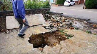 Man Arrives Home To Find A Hole In His Driveway That Reveals A Secret Room Under His House