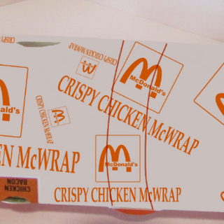 Crispy Chicken McWrap package in 2013 at RKO Food Store's 1983-styled McDonald's in Panama City.