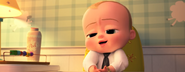 Boss Baby sitting and talking to Tim