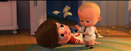 Boss Baby throwing money at Tim