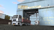 RidingShotgun-DPL-TrucksExitingGarage