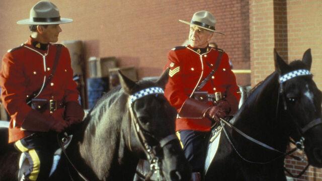 File:Constable Benton Fraser Sergeant Buck Frobisher on horses.jpg
