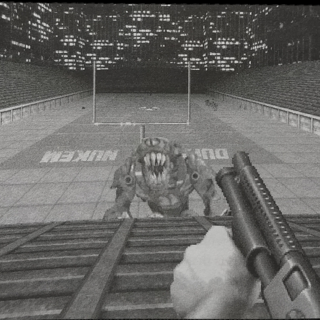 Screenshot of Stadium with sloped bleachers, included in an early Duke Nukem 3D guide book
