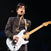 Musicology tour prince jamming on blue guitar