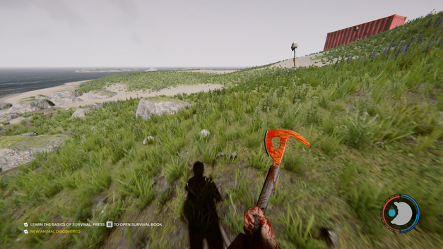 Standing with a bloody axe on a grassy hill.