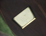 Plaque on Den Watts coffin (1 May 1990)