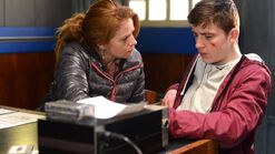 Liam Butcher and Bianca Butcher Walford Police Station (31 March 2013)