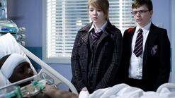 Abi Branning and Ben Mitchell visiting Jordan Johnson in Walford General Hospital (2010)