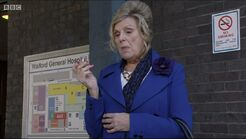 Cora outside Walford General Hospital