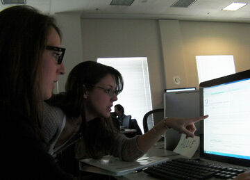 1280px-Lori and Allie Learn Together
