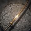 Золотой меч (миниатюра)
