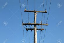 23337608-an-old-power-pole-carrying-11kv-and-lv-with-blue-sky-background