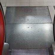 80s Melco escalator landing plate SP
